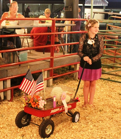 4-H youth and their animal at the livestock auction last year at the Wyandotte County Fair. (File photo by Steve Rupert)