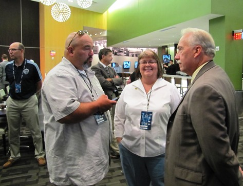 Talking before the training center news conference were, left to right, Bill Rogers, Unified Government Commissioner Jane Winkler Philbrook, and State Rep. Tom Burroughs. UG Administrator Doug Bach is on the left. (Staff photo)