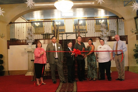 A ribbon-cutting was held Tuesday for the 7th Street Event Center, 735 Minnesota Ave., Kansas City, Kan. Also at the location today was a Kansas City, Kan., Chamber of Commerce Business Before Hours meeting.  At the ribbon-cutting were, left to right, Commissioner Jane Winkler Philbrook; Steve McConnell, operations manager-general manager; Michael Rosenthal, marketing director; Mike Johnson, owner-facilities manager; Maria Johnson, owner-events manager; Paul Ritchie, sales and social media manager; and Commissioner Brian McKiernan. (Photo from Bridget Koan, Kansas City, Kan., Chamber of Commerce)