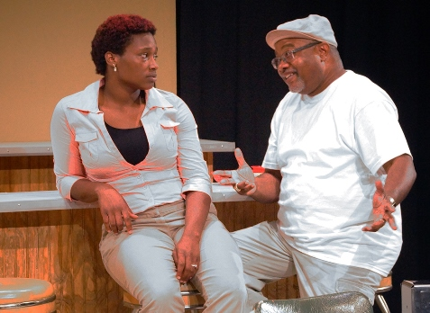 Zora, left, played by Aishah Harvey, with Roscoe, played by Granville T. O'Neal. (Photo courtesy of Melting Pot Theater Co.)