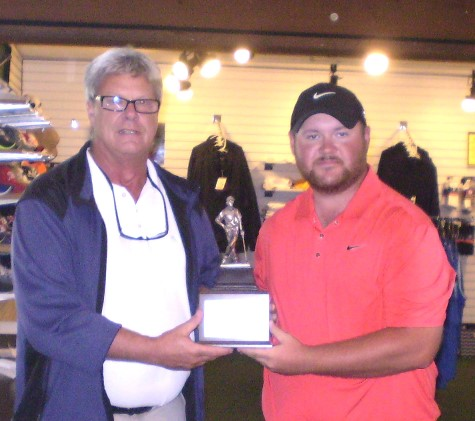 J.R. Munson, right, is presented his third Wyandotte County Open championship trophy by Sunflower Hills master golf professional Jeff Johnson. (Sunflower Hills photo by Chuck Ettinger)