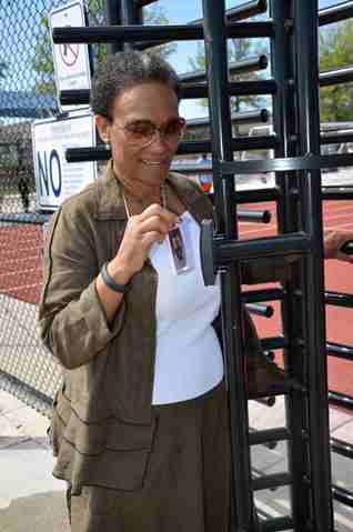 KCKCC President Doris Givens demonstrated how to use the new access system to the KCKCC track. (KCKCC photo)