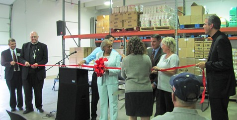 Those participating in the opening of the Hope Distribution Center today prepared for the ribbon-cutting. (Staff photo)