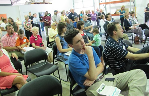 The audience listened to speeches at a ribbon-cutting and dedication today of the Hope Distribution Center in Kansas City, Kan. (Staff photo)