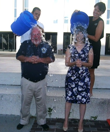 "Tonight Unified Government Commissioners Mike Kane and Angela Markley took the ice bucket challenge in front of City Hall to raise funds for ALS.  ""I didn't even cuss,"" Kane said after ice water was poured over his head. ""It was really a lot of fun. It really felt good,"" Markley, who challenged the other commissioners, said. The heat index was 99 degrees at 7 p.m. Aug. 25. This was done as part of the national ALS challenge, raising funds to fight the disease. (Photo by William Crum)"