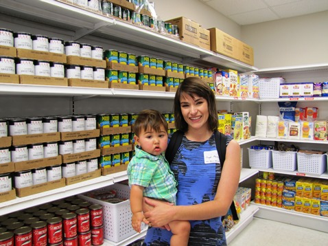 Unified Government Commissioner Angela Markley toured a new food pantry at a ribbon-cutting ceremony today. Markley helped put up the shelves at the food pantry. (Staff photo)