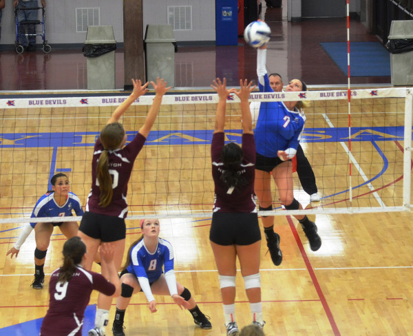KCKCC sophomore Blair Russell (7) soared for a kill against Hesston Wednesday night while teammates Kimberly Martinez (2) and Lily Cullers ready for a possible block in the Lady Blue Devils 3-0 win. (KCKCC photo by Rodney Christensen)