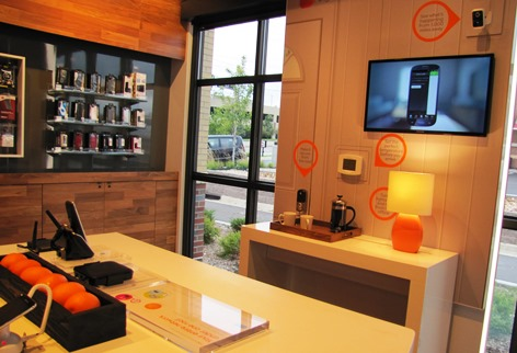 A home-like area in the new AT&T store discusses how a device can be used to turn off lights or lock the door remotely. (Staff photo)