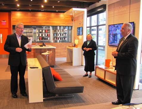 AT&T Kansas President Mike Scott, left, with Rep. Tom Burroughs, right, and Rep. Pam Curtis, center, at today's grand opening ceremony at 106th and Parallel Parkway. (Staff photo)