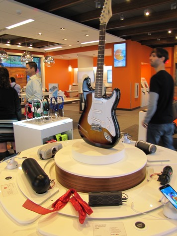 Visitors to the AT&T store may see a guitar, and see how it works together with electronic devices. (Staff photo)