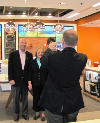 Former Mayor Joe Reardon took a snapshot at today's tour of the new AT&T store at 106th and Parallel. (Staff photo)