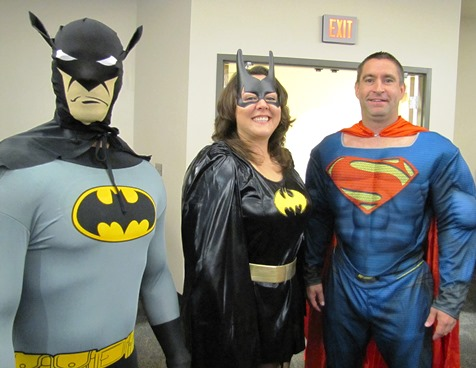 Playing superhero characters at today's United Way of Wyandotte County campaign launch were, left to right, Brince Rogers, Diana Weber and Danny Helmich. They are with the YMCA of Greater Kansas City. (Staff photo)