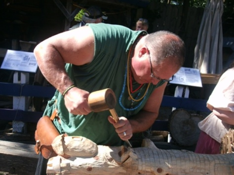 Dave Whisenhurt demonstrated carving recently at the Renaissance Festival in Bonner Springs. (Photo by William Crum)