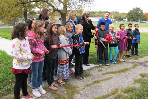 The ribbon was cut today for new sidewalks in the area of Matney Park and Junction Elementary School, near 42nd and Shawnee Drive. (Staff photo by Mary Rupert)
