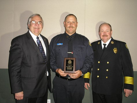 The Kansas City, Kan., Rotary Club recently gave its annual public safety professional award to Capt. Timothy R. Cottrell, center, from the Kansas City, Kan., Fire Department. Chief John Paul Jones, right, talked about the professionalism and heroism of Capt. Cottrell. (Photo from KCK Rotary Club)