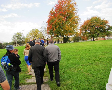 Those attending the ribbon-cutting today walked along a path at Matney Park. (Staff photo)