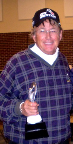 One of only three golfers to break 80, Bob Chatterton was presented the overall championship trophy in the WyCo Senior by master professional Jeff Johnson. (Photo by Chuck Ettinger)