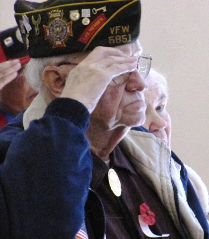 Homer Collier, Kansas City, Kan., a veteran of the Korean War, saluted the flag at the annual Veterans Day commemoration Nov. 8 at the Salvation Army Harbor Light Village, Kansas City, Kan. (Staff photo by Mary Rupert)