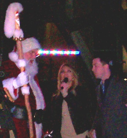 Santa Claus encouraged the crowd to get loud to turn on the lights Saturday at The Legends Outlets. (Staff photo)