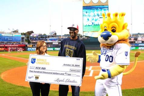 A check for $200,000 was presented to KCK RBI by the Royals Charities before Game 3 of the American League Championship Series. The money will go toward baseball field renovations at the former 3&2 field at 53rd and Parallel Parkway. (Photo from KCK RBI)