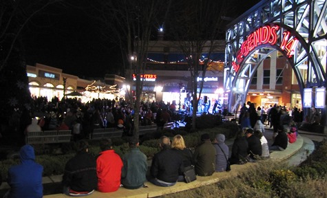 A large crowd turned out to watch the holiday lights turned on Saturday night at The Legends Outlets in Kansas City, Kan. (Staff photo)