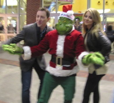 The Grinch was spotted in the background at the holiday lighting Saturday at The Legends Outlets.