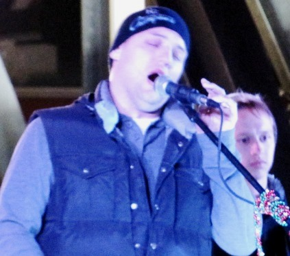 The crowd was entertained by live music before the holiday lighting Saturday at The Legends Outlets. (Staff photo)