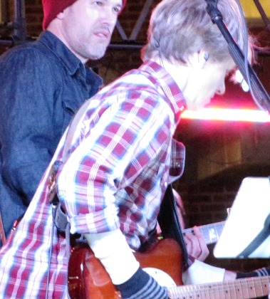 The crowd was entertained by live music Saturday before the holiday lighting at The Legends Outlets. (Staff photo)