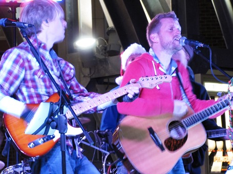 The crowd was entertained by live music before the holiday tree lighting Saturday at The Legends Outlets. After the tree was lit, Christmas carols were sung. (Staff photo)