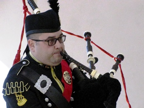 "The Kansas City, Kan., Police Department Bagpipers participated in the presentation of the colors, and also performed ""Amazing Grace,"" at the annual Wyandotte County Veterans Day commemoration Nov. 8 at the Salvation Army Harbor Light Village, Kansas City, Kan. (Staff photo by Mary Rupert)"