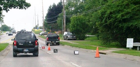 Cones had been set up along Parallel Parkway, in this file photo from August, to direct traffic near a mobile food pantry site on Saturdays on Parallel Parkway. (File photo)
