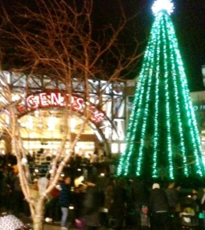 The 45-foot tree in the center courtyard came alive with synchronized lights Saturday at The Legends Outlets, Kansas City, Kan.