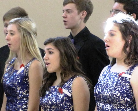 "The Piper High School Music in Motion group, directed by Shelly Cole, performed the national anthem and ""God Bless America"" at the annual Wyandotte County Veterans Day commemoration Nov. 8 at the Salvation Army Harbor Light Village, Kansas City, Kan. (Staff photo by Mary Rupert)"