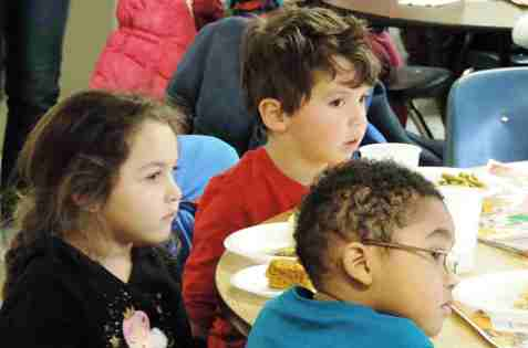 Volunteers read to children who attend KCKCC's Campus Child Care Center during the center's annual Thanksgiving Lunch. (KCKCC photo)