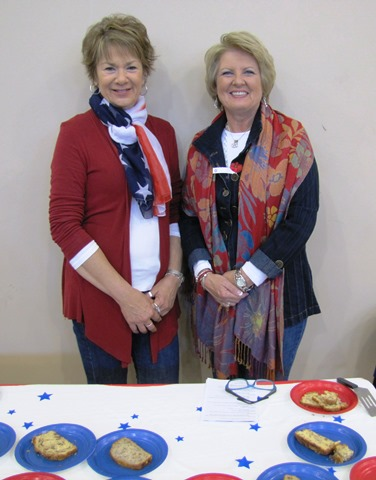 Linda Lewis and Therese Bysel staffed a refreshment table at the annual Wyandotte County Veterans Day commemoration Nov. 8 at the Salvation Army Harbor Light Village, Kansas City, Kan. (Staff photo by Mary Rupert)
