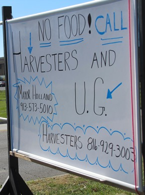 A sign in front of the CrossRoads Family Church urged people to call the local government and food bank to get the food distribution site restored.