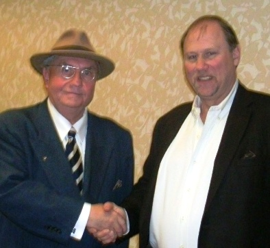 Raymond Starzman, left, gave a speech portraying Harry Truman, and visited with Scott Mackey, right, Wyandotte County Democratic Party chairman, during a meeting Saturday. (Photo by William Crum)