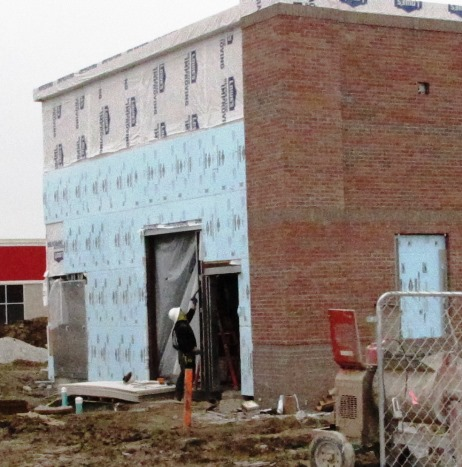 Construction work continued today on a new Krispy Kreme building at Wyandotte Plaza, 78th and State Avenue. (Staff photo by Mary Rupert)