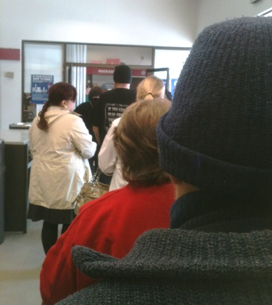 Customers faced long lines at a local post office toward closing time on Saturday, Dec. 20.