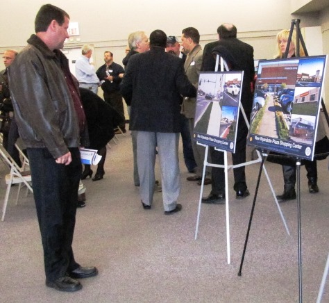Those attending the meeting viewed signs showing current and past photos of Wyandotte Plaza and State Avenue. (Staff photo by Mary Rupert)