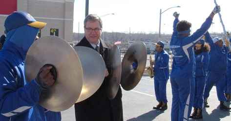 Krispy Kreme vice president Stephen Graves played the cymbals today with the Schlagle High School band. (Staff photo by Mary Rupert)