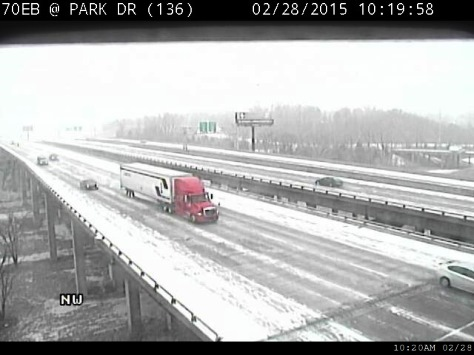 A truck made its way on eastbound I-70 at Park Drive as snow fell on Saturday morning. (KC Scout photo)