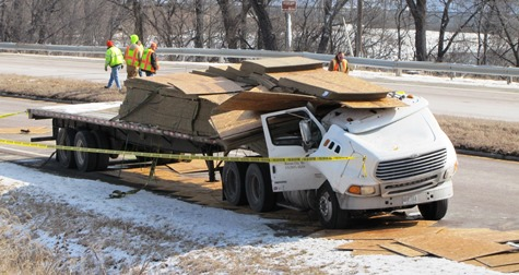 A truck's load shift is the apparent cause of a fatal accident this morning on K-32 near 78th Street in Kansas City, Kan. (Staff photo by Mary Rupert)