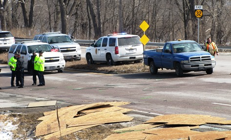 K-32 was closed from about Swartz Road to 78th Street after a fatal accident this morning. Plywood boards were scattered on K-32 following the accident. (Staff photo by Mary Rupert)