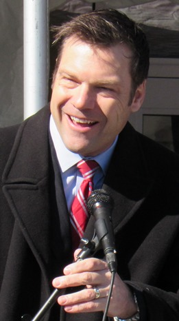 Kansas Secretary of State Kris Kobach today welcomed Krispy Kreme to Kansas City, Kan., and added he would be using the drive-through there often. (Staff photo by Mary Rupert)