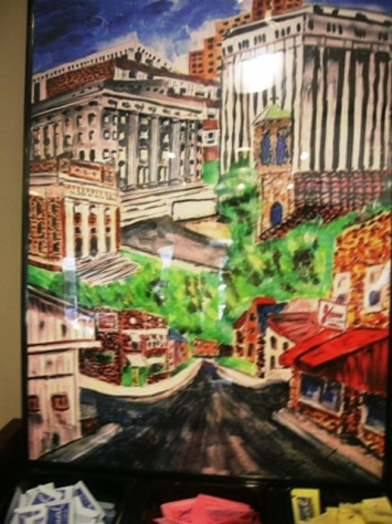 Artwork inside the Cup on the Hill coffee shop showed some Kansas City, Kan., buildings. (Photo by William Crum)