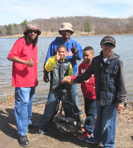 Fishing was a father and son event for some today at the opening day of fishing at Wyandotte County Lake. The three children in front are Jayvius Smith, T.J. Williams and Jameer Smith, and the adults are Andre Porter, left, and Jelani Smith (in the blue Jayhawks jacket). All are from Kansas City, Kan. (Staff photo by Mary Rupert)