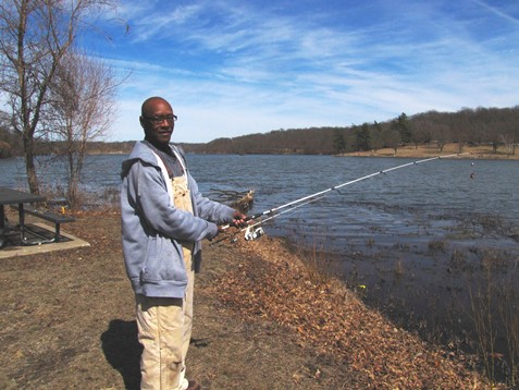 Michael Mallard, Kansas City, Kan., was at Wyandotte County Lake for opening day of fishing, something he enjoys going to when he can. He caught two catfish. He was with his high school friend. (Staff photo)