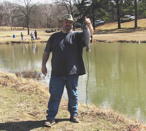 Tommy Wilson, Kansas City, Kan., displayed a rainbow trout he caught on opening day of fishing at Wyandotte County Lake. He said he enjoys fishing at the lake. (Staff photo)