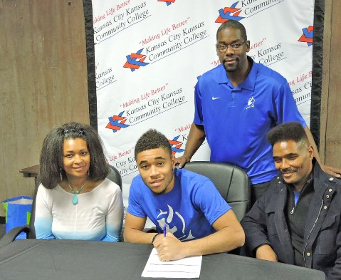 Flanked by his parents, Carla and Kevin Wyatt, Tim Wyatt signed a letter of intent to play basketball for Kansas City Kansas Community College and coach Kelley Newton, standing. (KCKCC photo by Alan Hoskins)